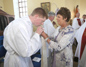 REPRO FREE  19/07/2015;       Rev. Shane O'Neill, Knockanore and newly ordained Priest for the diocese of Waterford and Lismore, receives the stole from his Mother, Patricia, during his ordination in the Church of The Sacred Heart, Knockanore, Co. Waterford. Picture: John Hennessy