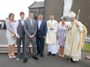 REPRO FREE  19/07/2015;       Bishop Alphonsus Cullinan DD, Bishop of Waterford & Lismore, with Rev. Shane O'Neill, Knockanore and newly ordained Priest for the diocese of Waterford and Lismore, and his family, Fiona, Darren, Cathal, Dad; Thomas and Mum; Patricia after Shane's ordination in the Church of The Sacred Heart, Knockanore, Co. Waterford. Picture: John Hennessy