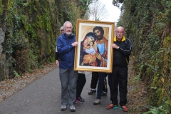 Gerard Enright and Tom Moroney pause on their journey from Durrow to Abbeyside along the Greenway carrying the the Icon of the Holy Family and prepare to lead the procession from the Ballinroad Greenway car-park to Abbeyside Church. (Tom Keith)
